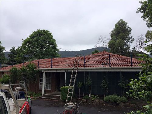 Roof Restoration with safery railings